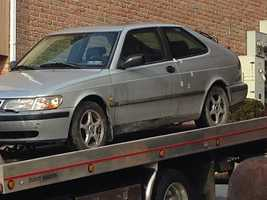 A blood-marked car was towed from the scene by police.