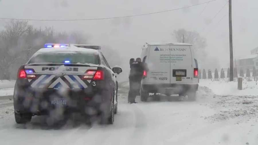 Two officers try to free a stuck van on Route 441 in Lancaster County. Watch raw video here.
