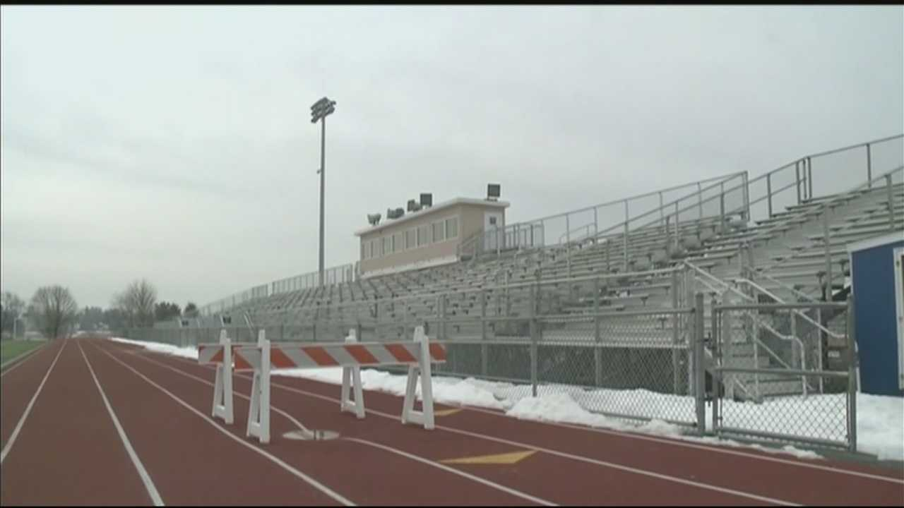 Hurdles on a high school track are being used to cover an area that's sinking.