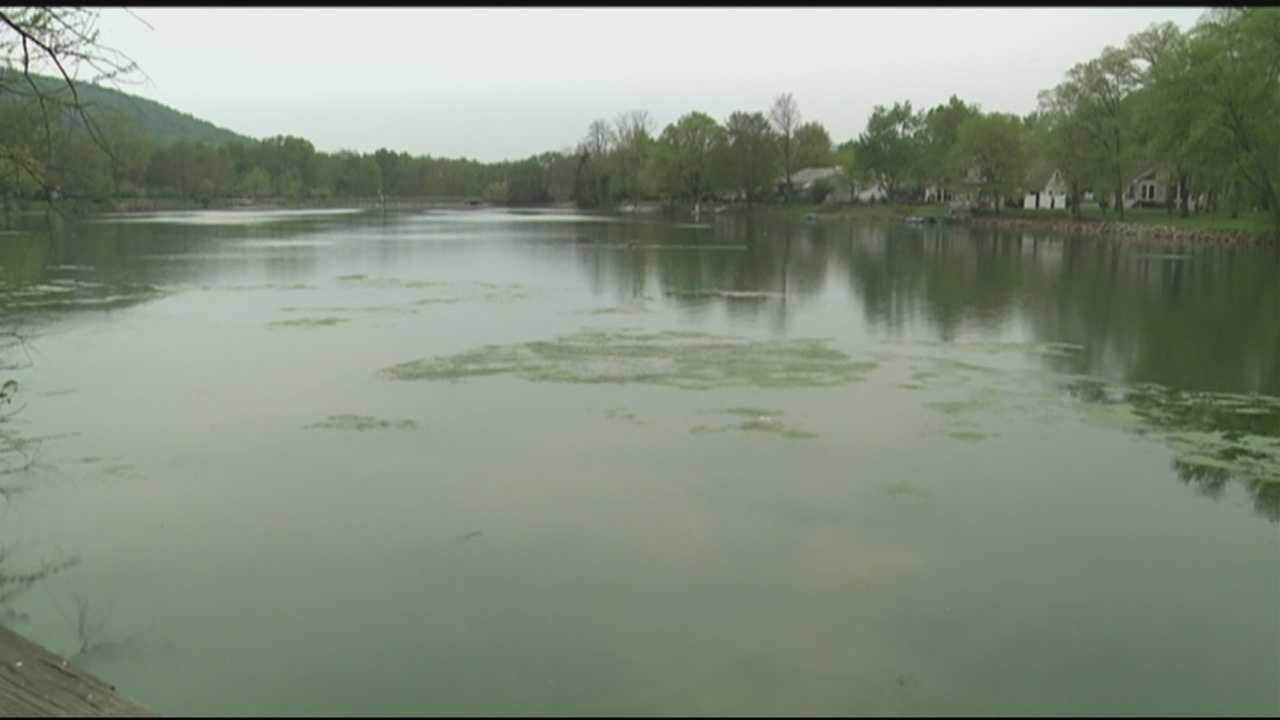 Investigators are looking for the person who beheaded a dog and dumped its body in an Adams County lake.