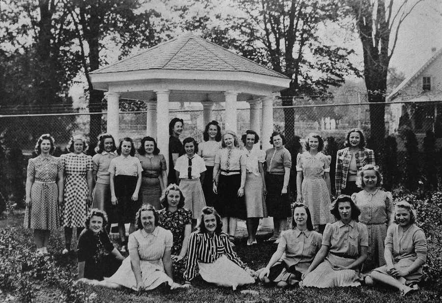 Can you guess which one is her in this yearbook photo? [Arthur is leaning on the left-side pillar of the gazebo.]