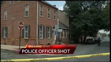 The shooting occurred at an apartment at 305 East Chestnut Street around 12:30 p.m.