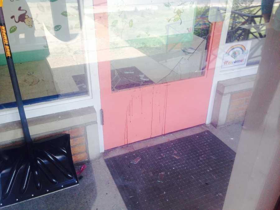 Broken glass and blood litter the front ofGrowing Adventures Child Development Center in Harrisburg.