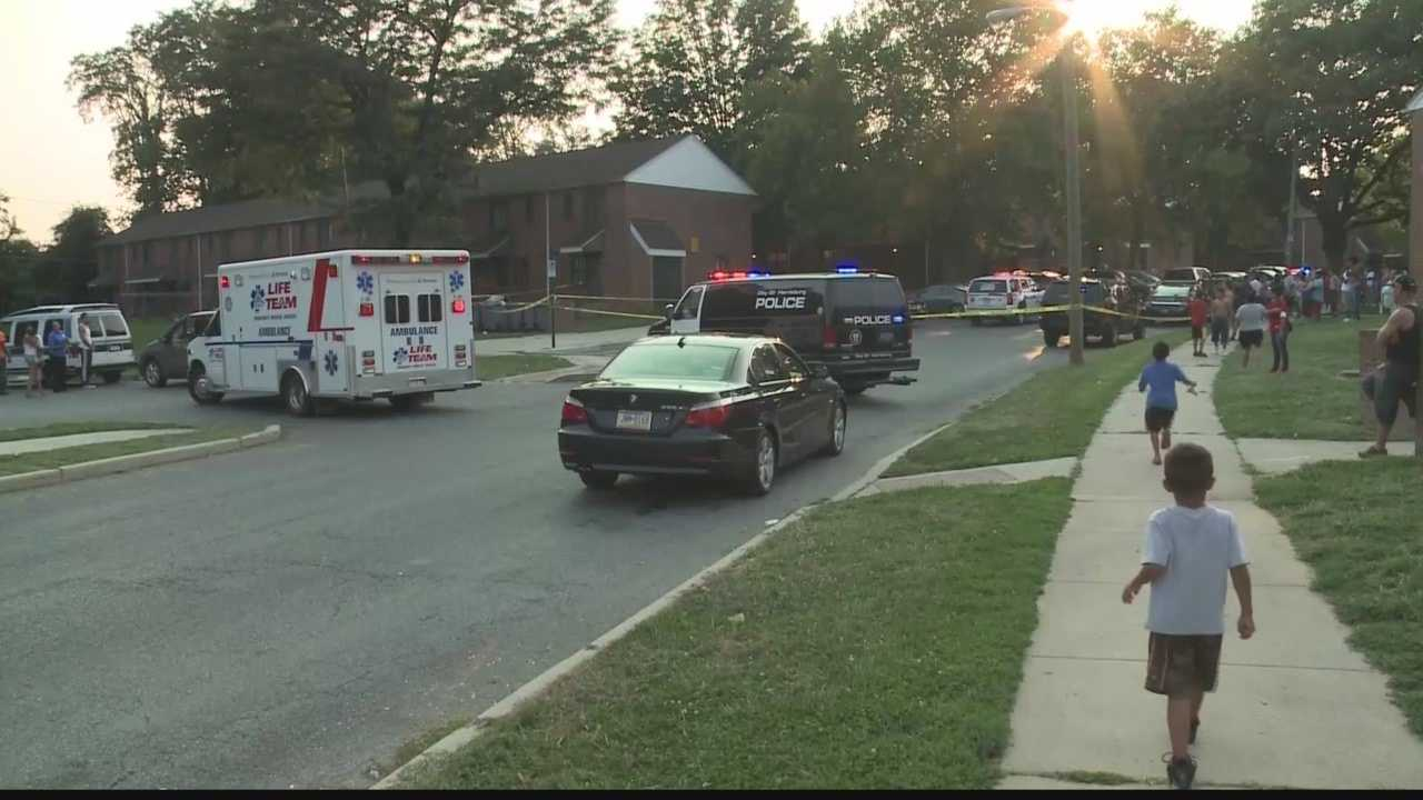 Police say someone fired more than a dozen shots on a crowded Harrisburg street Wednesday evening, injuring two people.
