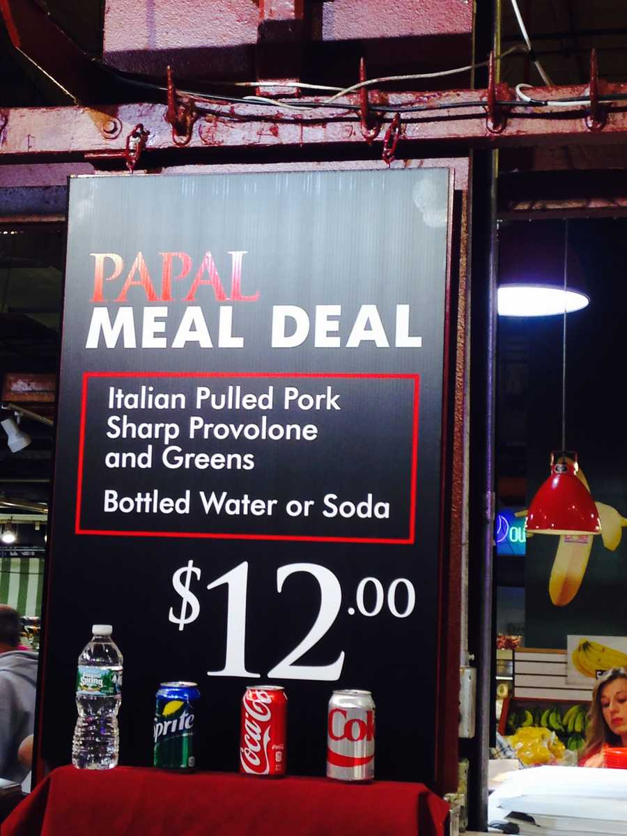 "One Reading Terminal Market stand offered this ""Papal Meal Deal"": An Italian pulled pork sandwich with a drink for $12 bucks!"
