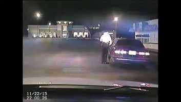 Police have released video that shows just how close a police officer came to being shot in the head at point blank range by a suspect.