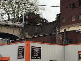 MULTIPLE COLLAPSES: Crews on the scene are reporting that multiple other buildings have partially collapsed because of the incident, including: McFarland Press Building at 1139 Mulberry Street and three other buildings along Cameron Street.