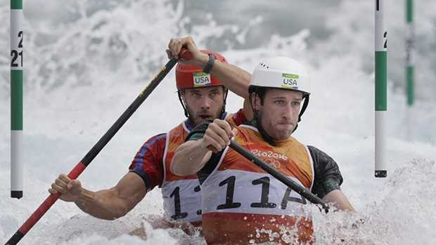 AP Photo: Casey Eichfeld, left, competes in the men's double canoe.
