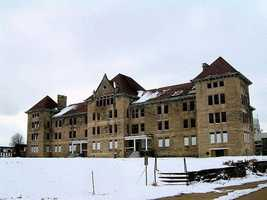 """The Peoria State Hospital, an abandoned mental hospital in Bartonville, Ill., is the scene of the ghost of """"Old Book,"""" a patient who worked with the burial crew until his own death."""
