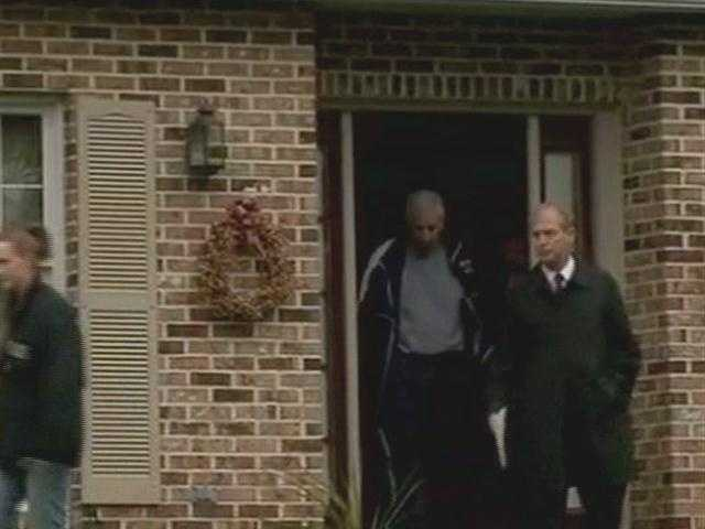 This slideshow shows Sandusky being taken from his home to a waiting car.