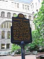 Pittsburgh's original courthouse occupied in 1794 was a wooden structure located next to the market place.