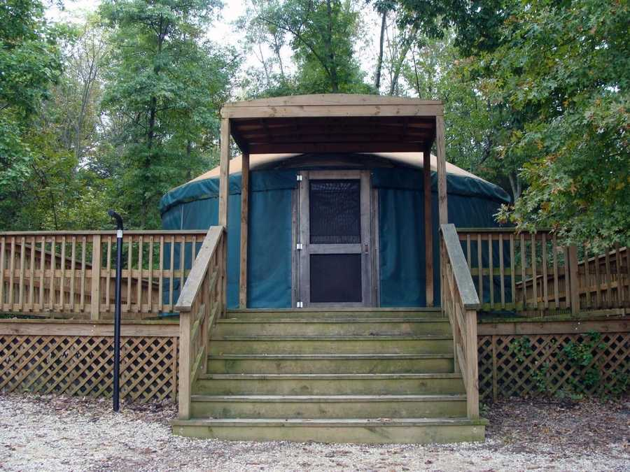 Yurts have a cooking stove, refrigerator, countertop, table, chairs, electric lights, electric heat, outlets, fire ring, and picnic table. A nearby bathhouse provides toilets, showers, drinking water and a dish-washing station.