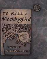 """4. To Kill a Mockingbird by Harper Lee: Challenged and temporality banned due to the words """"damn"""" and """"whore lady"""" used in the novel. Also seen as a """"filthy, trashy novel"""" that does """"psychological damage to the positive integration process"""" and """"represents traditional racism under the guise of good literature."""""""