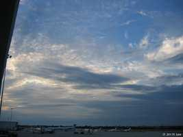 They usually cover the entire sky and often form ahead of storms with continuous rain or snow.