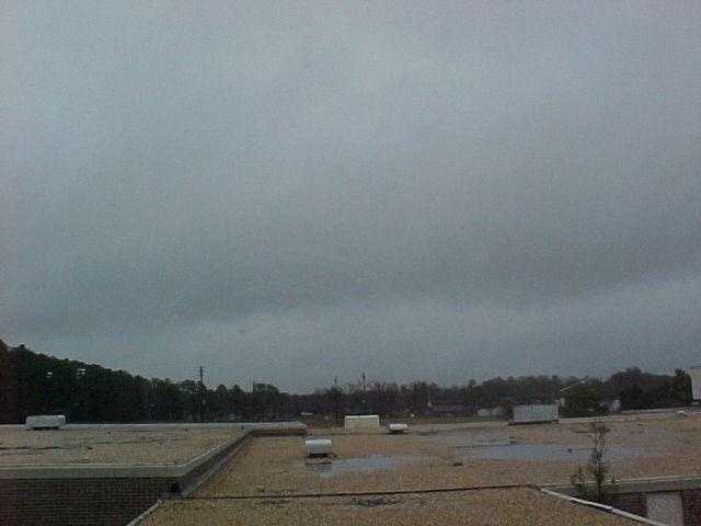 Nimbostratus clouds form a dark gray, wet-looking cloudy layer associated with continuously falling rain or snow.