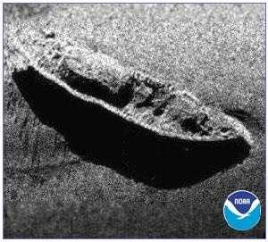 It now lies 230 feet below the ocean surface. This image shows a NOAA side sonar scan of the wreck.