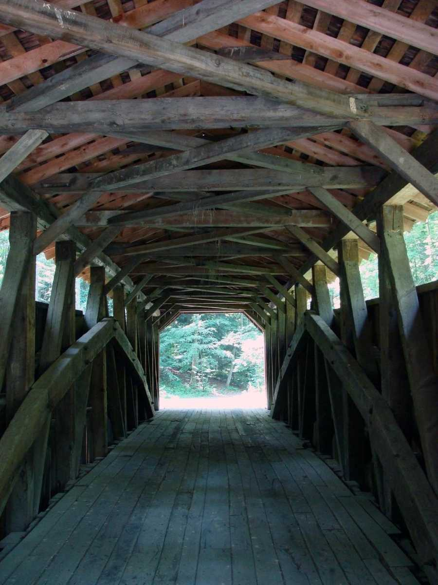 The bridge represents the Burr-arch construction with each interior side of the bridge featuring a large structural arch.