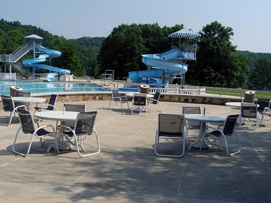 The pool varies in depth from one to five feet and has 11- and 17-foot water slides and a spray ground. No coolers, food or drinks are allowed inside the pool area.