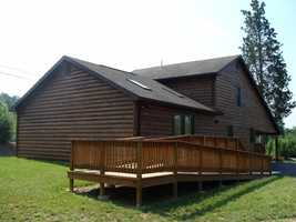 The ADA accessible cabin sleeps 12 people in three bedrooms. Amenities include heat and air conditioning, stove, refrigerator, microwave and dishwasher.