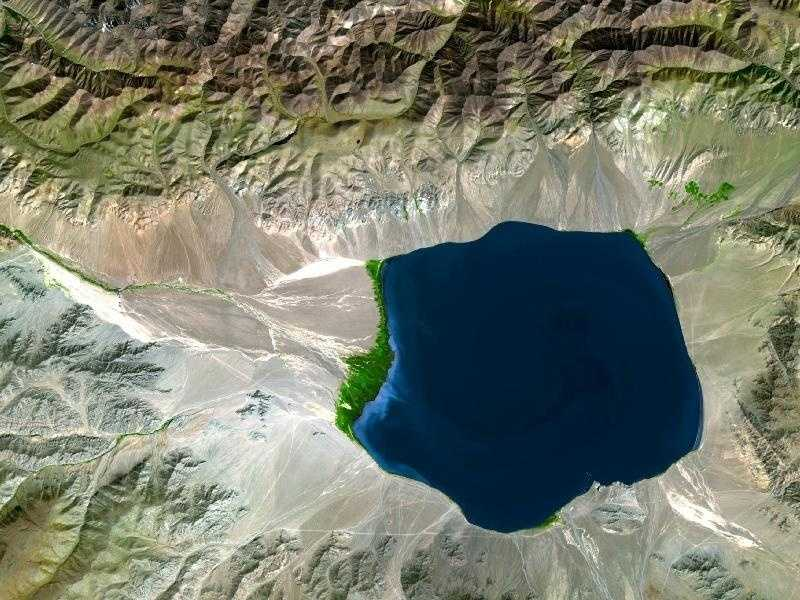 The Uvs Nuur Basin sits on the northern edge of the Central Asian steppes, bounded on all sides by mountains. Though largely arid, the basin is dotted with water. A large salt lake, the Uvs Nuur Lake, sits at the center of the basin, and several smaller lakes are scattered across the region. Rivers, the largest of which is the Tes-Khem, run from the surrounding mountains into the basin, but no rivers flow out of the basin. This image shows one of the smaller lakes near the western edge of the basin.