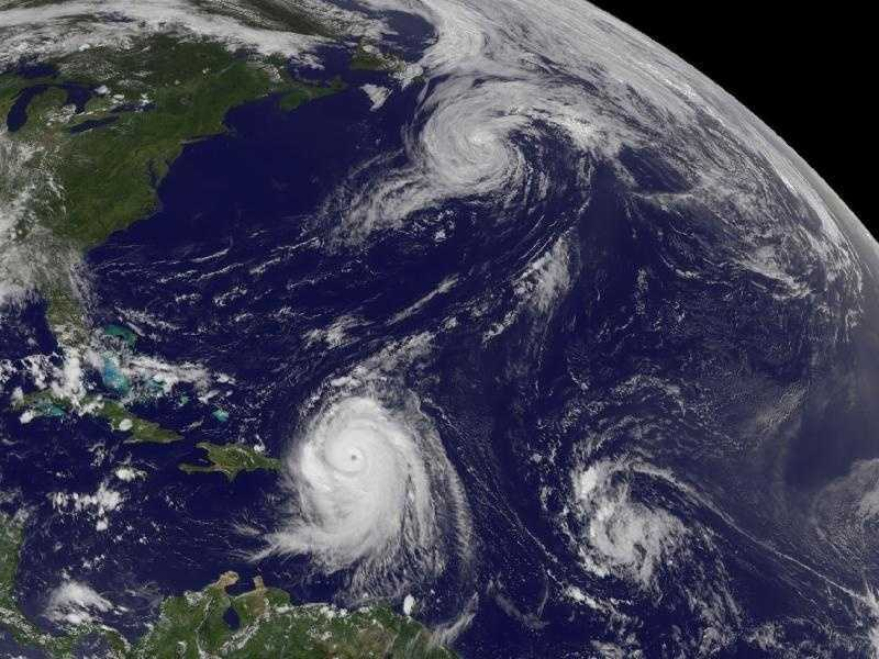 The current Geostationary Operational Environmental Satellite GOES-13 captured this image of Hurricane Danielle heading for the north Atlantic (top center), Hurricane Earl with a visible eye hitting the Leeward Islands (left bottom) and a developing tropical depression 8 (lower right) at 1:45 p.m. EDT on Aug. 30.