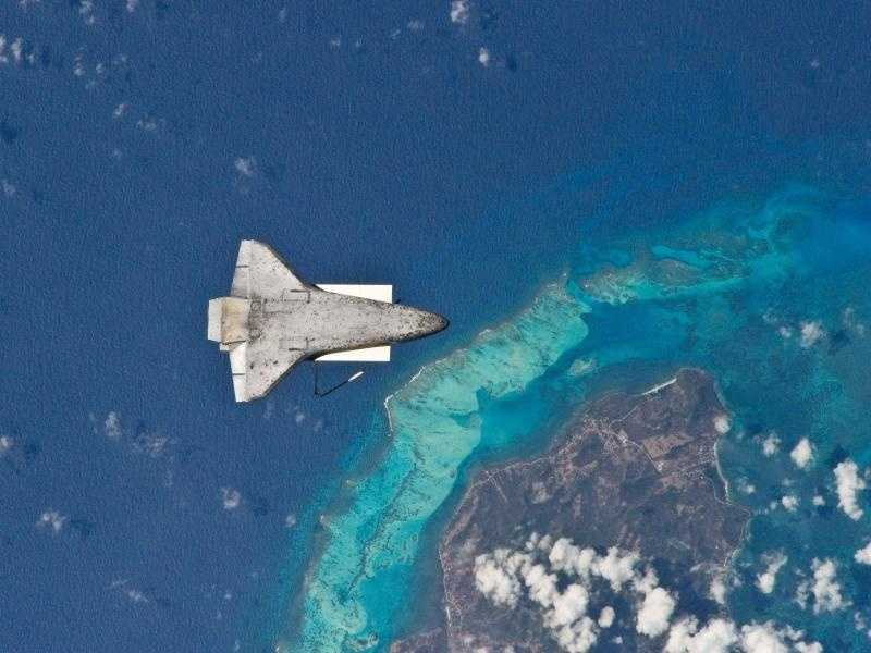 As the shuttle and the space station began their post-undocking relative separation, Expedition 23 flight engineer Soichi Noguchi photographed the underside of the shuttle over the south end of Isla de Providencia, about 150 miles off the coast of Nicaragua. Undocking of the two spacecraft occurred on April 17, 2010, ending the shuttle's 10-day stay. The visit included three spacewalks and delivery of more than seven tons of equipment and supplies to the station.