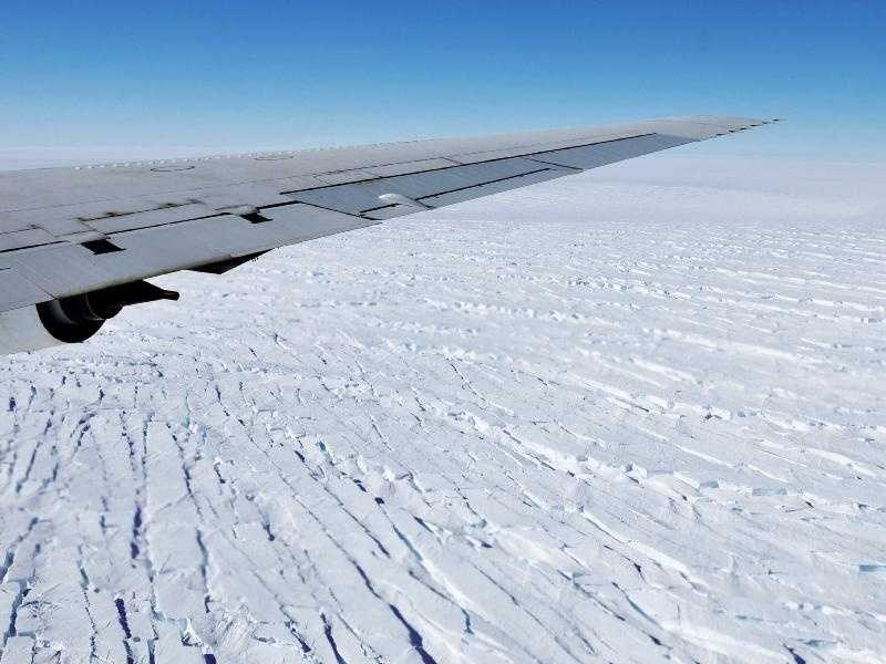 West Antarctica's massive Pine Island Glacier is seen out the window of NASA's DC-8 research aircraft as it flies at an altitude of 1,500 feet, Tuesday, Oct. 27, 2009. This was the seventh science flight of NASA's Operation Ice Bridge, an airborne Earth science mission to study Antarctic ice sheets, sea ice and ice shelves. The glacier is one of the primary targets of the mission because of the rapid rate at which it is losing ice to the sea.
