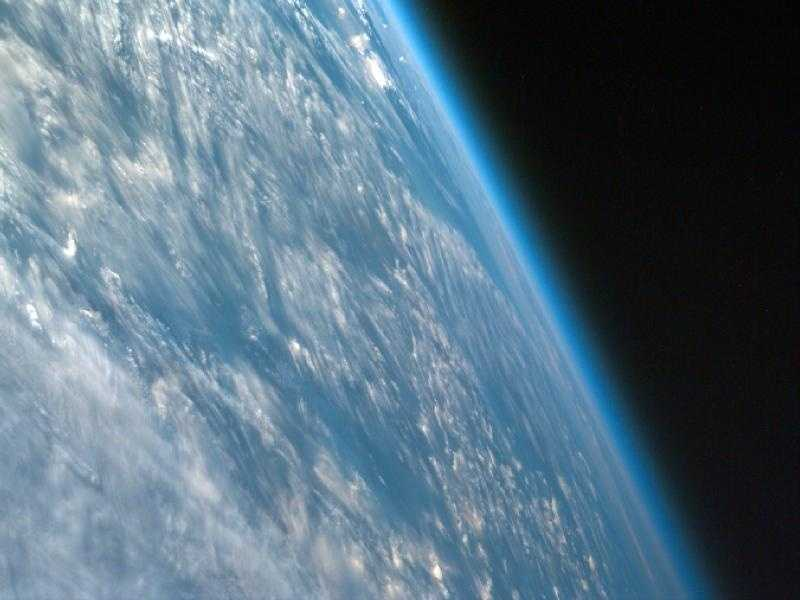 Most ISS images are nadir, in which the center point of the image is directly beneath the lens of the camera, but this one is not. This highly oblique image of northwestern African captures the curvature of the Earth and shows its atmosphere.