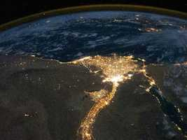 In this view of Egypt, the Nile River and its delta look like a brilliant, long-stemmed flower in this photograph of the southeastern Mediterranean Sea, as seen from the International Space Station. The Cairo metropolitan area forms a particularly bright base of the flower. The smaller cities and towns within the Nile Delta tend to be hard to see amidst the dense agricultural vegetation during the day, but they become clearly visible at night.