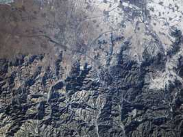 The Great Wall of China and Inner Mongolia are featured in this image photographed by Expedition 10 Commander Leroy Chiao on the International Space Station. Despite myths to the contrary, the wall isn't visible from the moon, and is difficult or impossible to see from Earth orbit without the high-powered lenses used for this photo.