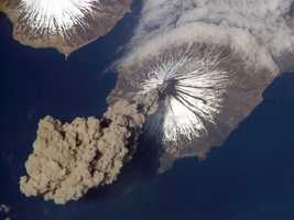 On May 23, 2006, Expedition 13 astronaut Jeff Williams contacted the Alaska Volcano Observatory to report that the Cleveland Volcano had produced a plume of ash. Shortly after the activity began, he took this photograph from the International Space Station.