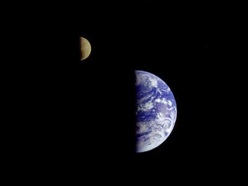 This picture of the Earth and Moon in a single frame was taken by the Galileo spacecraft from about 3.9 million miles away. Antarctica is visible through clouds (bottom). The Moon's far side is seen&#x3B; the shadowy indentation in the dawn terminator is the South Pole Aitken Basin, one of the largest and oldest lunar impact features.