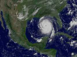 NASA spacecraft watched closely in 2005 as a record-breaking Atlantic hurricane season yielded 27 named storms, including the devastating Hurricane Katrina, seen here at full strength in an Aug. 29, 2005 image from the GOES-12 weather satellite.