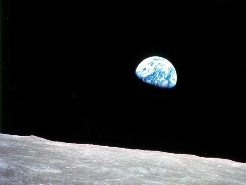 Apollo 8, the first manned mission to the moon, entered lunar orbit on Christmas Eve, Dec. 24, 1968. That evening, the astronauts--Commander Frank Borman, Command Module Pilot Jim Lovell, and Lunar Module Pilot William Anders--held a live broadcast from lunar orbit, in which they showed pictures of the Earth and moon as seen from their spacecraft.