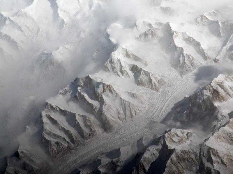 The Tien Shan mountain range in Central Asia is one of the largest continuous mountain ranges in the world. This image taken by the Expedition 27 crew aboard the International Space Station provides a view of the central Tien Shan, about 40 miles (64 kilometers) east of where the borders of China, Kyrgyzstan, and Kazakhstan meet.