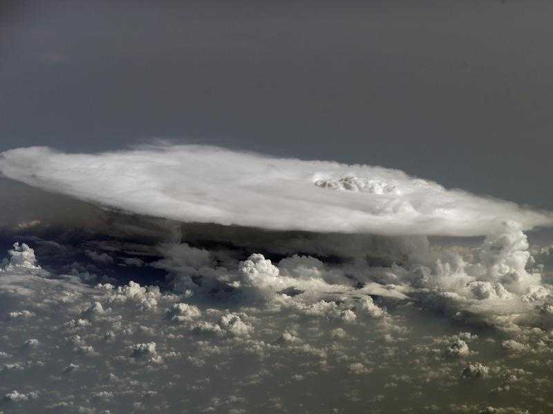 High above the African continent, tall, dense cumulonimbus clouds, meaning 'column rain' in Latin, are the result of atmospheric instability. The clouds can form alone, in clusters, or along a cold front in a squall line. The high energy of these storms is associated with heavy precipitation, lightning, high wind speeds and tornadoes.
