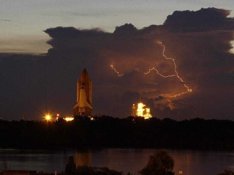 Rollout of space shuttle Discovery was slow-going due to the onset of lightning in the area of Launch Pad 39A at NASA's Kennedy Space Center in Florida.