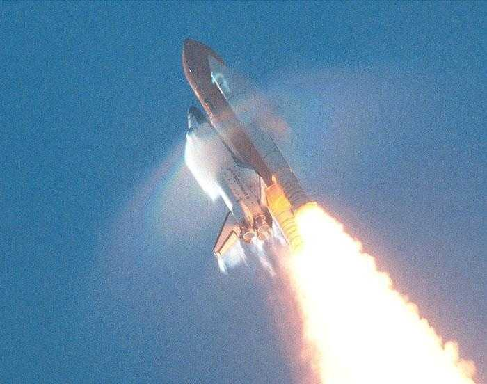 This view of the shock wave condensation collars backlit by the sun occurred during the launch of Atlantis on STS-106. One frame was digitized to make this still image. Although the primary effect is created by the Orbiter forward fuselage, secondary effects can be seen on the SRB forward skirt, Orbiter vertical stabilizer and wing trailing edges (behind SSME's).