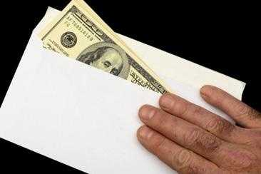 """Envelope Stuffing: For a """"small"""" fee, the ad says, you'll learn how to earn lots of money stuffing envelopes at home."""