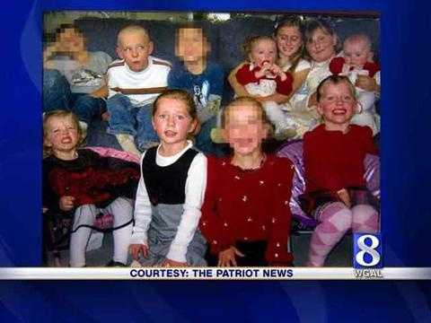 The children are shown in this Christmas photo with their cousins (faces blurred). Top row: Brady, 7, second from left&#x3B; Miranda,1, fourth from left. Next to Miranda is Christina, 11&#x3B; Isabelle, 9&#x3B; and Samantha, 9 months. Bottom row, Leah, 3 (Leah survived the fire)&#x3B; next to Hannah, 6 (in black and white)&#x3B; and Heidi, 4, far right. The cousins pictured were not involved in the fire.