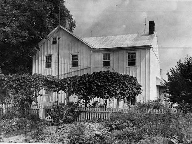 Here's a Library of Congress photograph of the house some time after the battle. No date was provided, but it's clear that the house had changed since the battle. The addition is present and the log beams are not exposed.