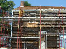 The addition has been removed and the beams are once again being restored and exposed.