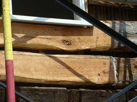 The oak beams aren't just being exposed. Some of them are also being replaced. The lighter colored logs seen here are new. Great attention has been paid to the wood. The home was built with Gettysburg oak. The replacement logs are also Gettysburg oak.
