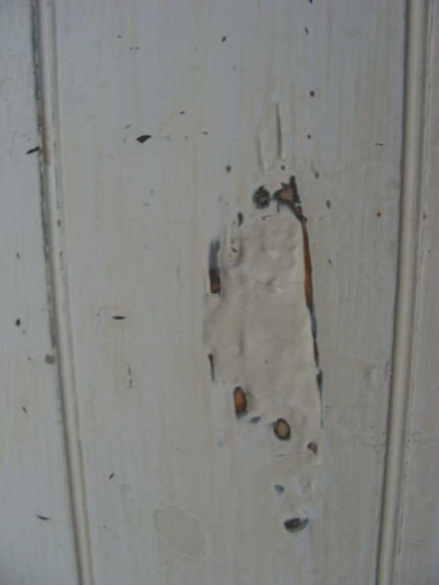 There are signs of the battle inside the home. Some bullet holes have been patched.