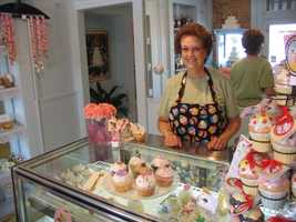 Pat Hopkins helps sell sweets at a cupcake shop in downtown Lititz.