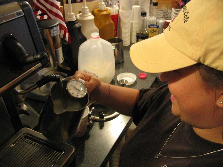 Alicia Stapleton, of Denver, brews a latte at a coffee shop.