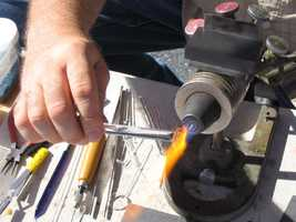 Chris Bryan, of The North Star of Lititz, uses a 2,000-degree flame to make a pendant.