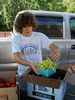Josh Kintzer, of Lititz, packages beans to sell at the Lititz Farmers Market.