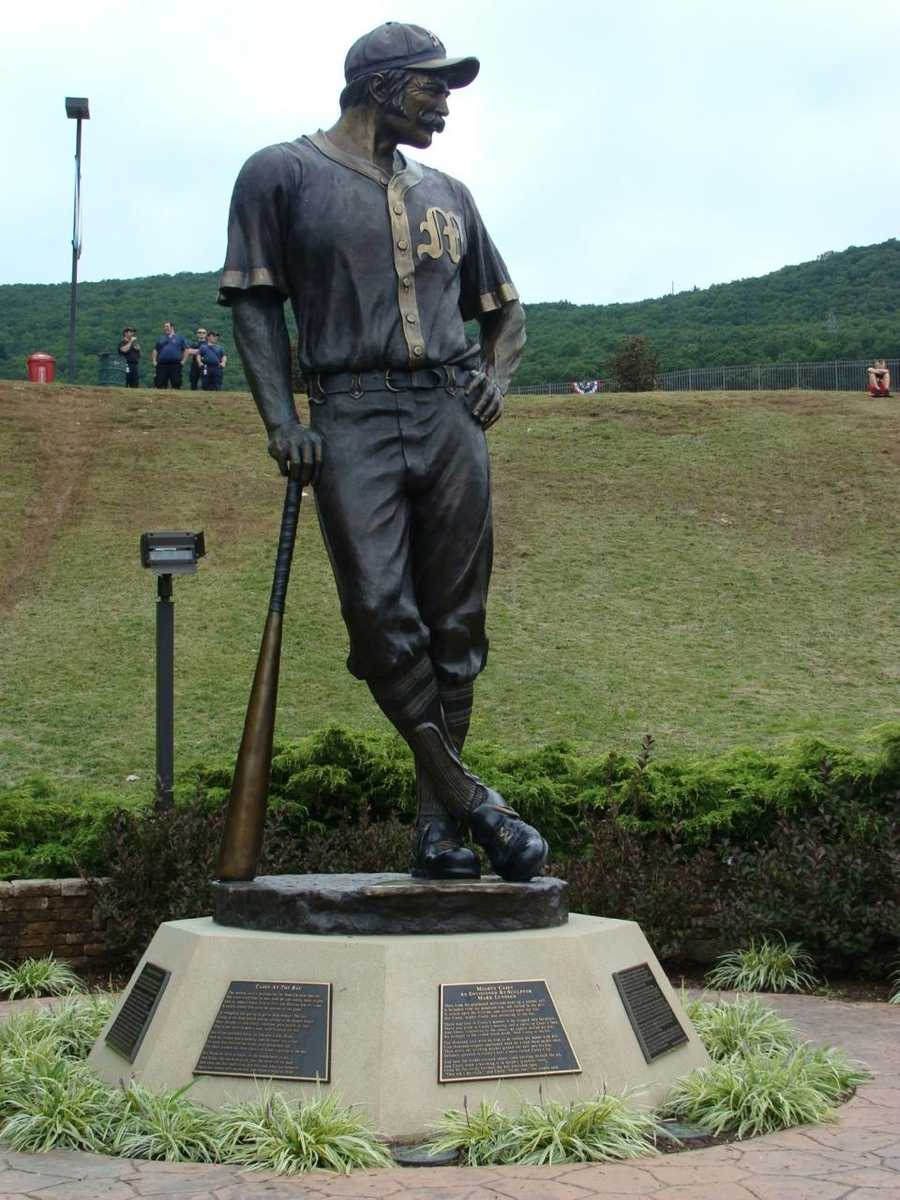 """Casey at the Bat"" monument beyond the left field fence at Lamade Stadium."