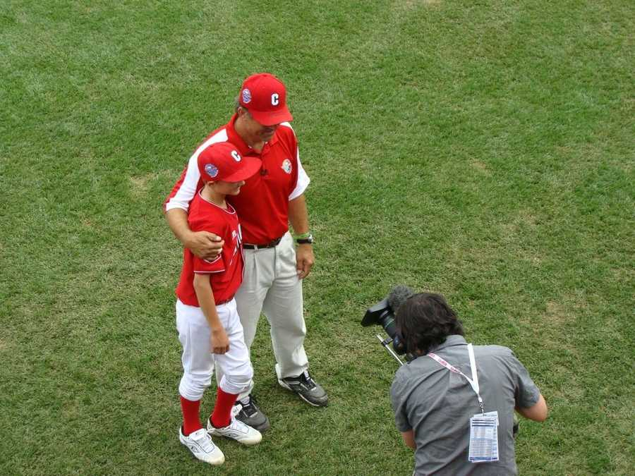 Team Canada coach and player are videotaped by ESPN during the 2010 LLWS.